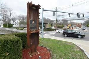 Travelers pass by the Glenville Fire House in Greenwich where a piece of steel from the one of the World Trade Center towers has been placed a memorial. The fire company will hold a 9/11 memorial ceremony on Friday at 6:30 p.m.