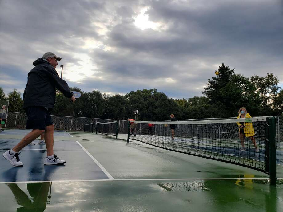 Saturday morning, about 50 people turned out at the pickleball courts near the corner of U.S. 31 and Bridge Street between Victorian City Car Port and West Shore Bank. Photo: Arielle Breen/News Advocate
