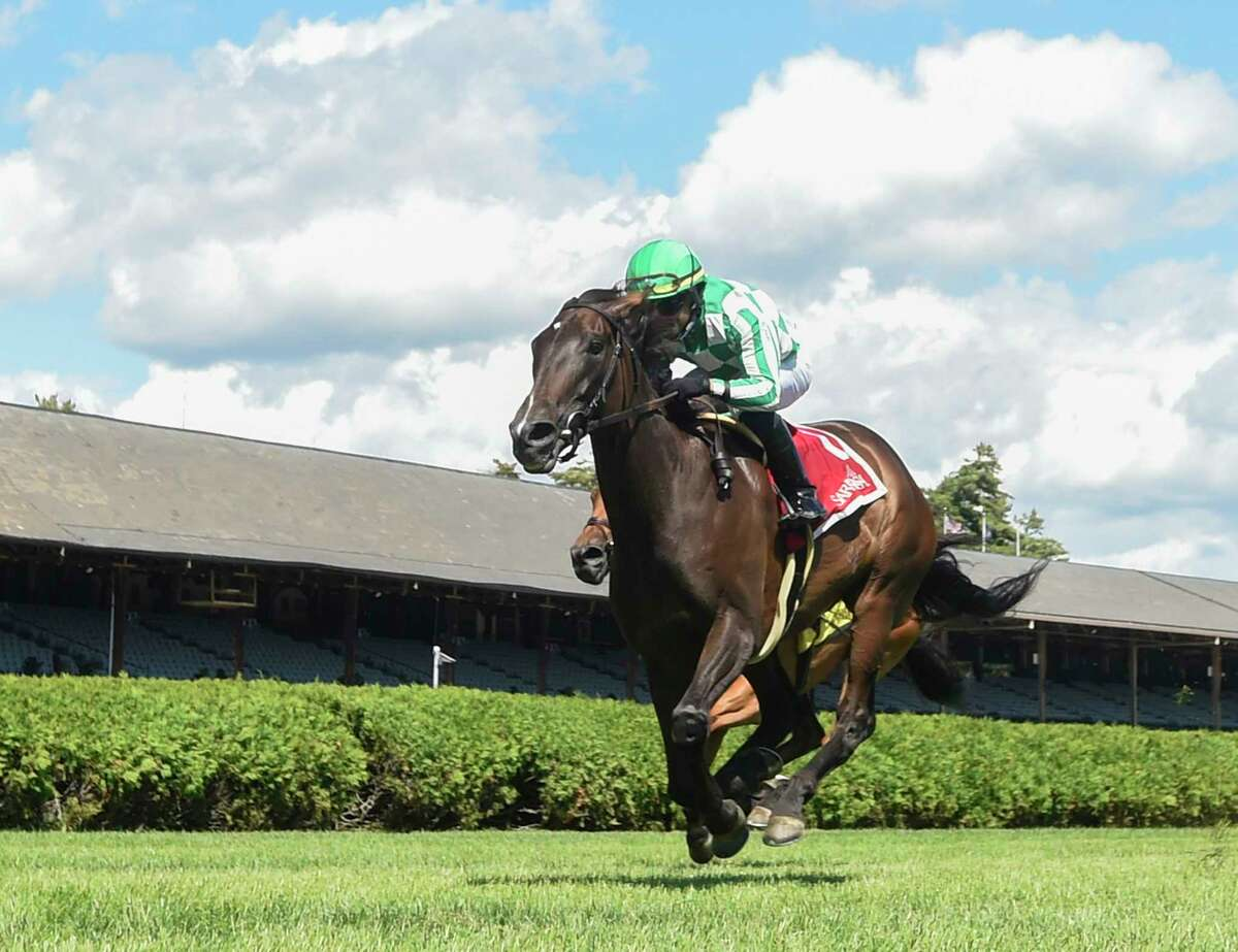 The New York Racing Association released its scheduled for this summer's racing season at Saratoga Race Course. In this photograph, Civil Union ridden by Joel Rosario wins The Glens Falls at the Saratoga Race Course Saturday Sept. 5, 2020 in Saratoga Springs, N.Y. Photo by Tim Lanahan.