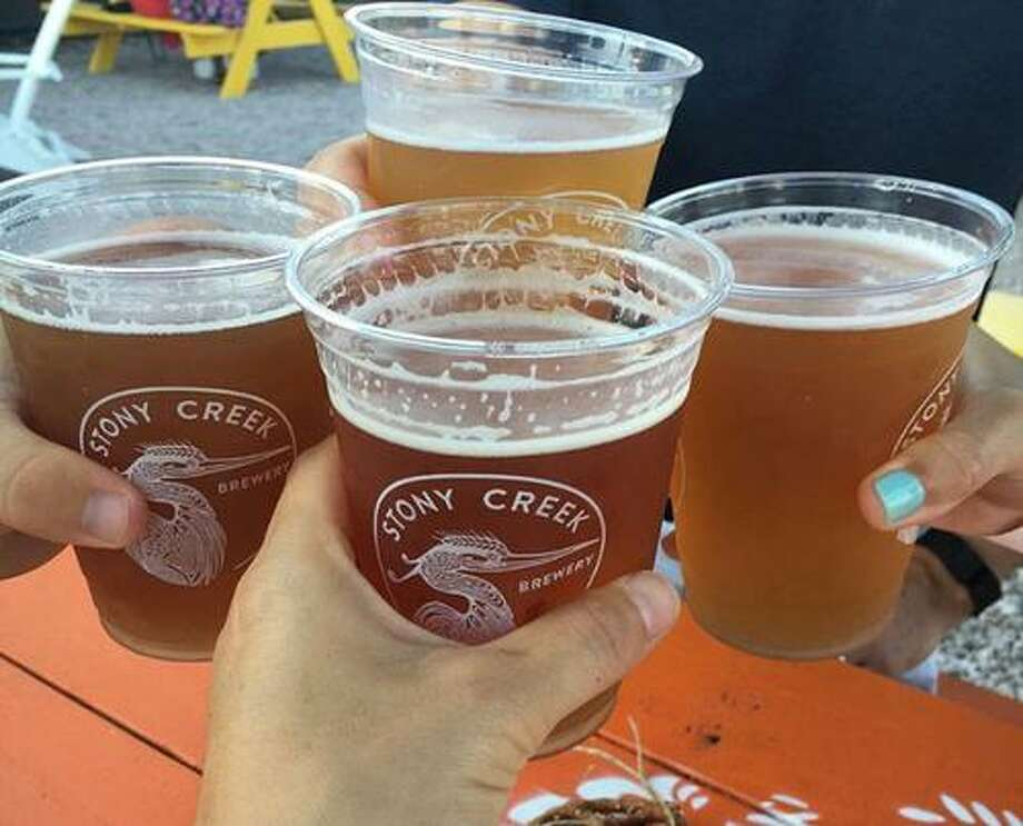 Friends toast a birthday at Stony Creek Brewery. Photo: Cathy Amarante / Contributed Photo