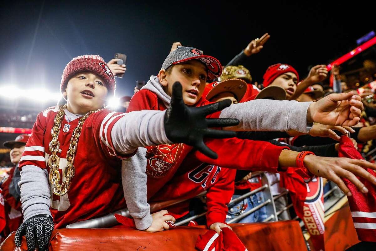 San Francisco 49ers fans reach out for players after the 49ers defeated the Green Bay Packers at the NFC Championship game at Levi�s Stadium on Sunday, Jan. 19, 2020 in Santa Clara, California. The San Francisco 49ers defeated the Green Bay Packers 37-20.