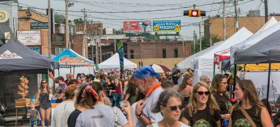 Crowds filled East Broadway in Alton at last year's Mississippi Earthtones Festival, which has been modified for this year's event to be held Saturday, Sept. 19, due to safety precautions brought about by the coronavirus pandemic. Photo: File Photo