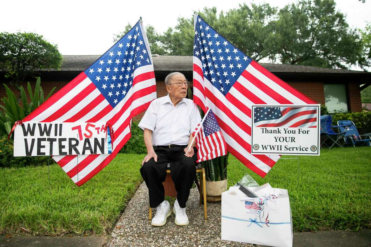 WWII veteran Bock Mah watches the passing cars during a parade honoring seven WWII Chinese American veterans for the 75th anniversary of the end of WWII hosted by the Chinese American Citizens Alliance in Houston on Saturday, Sept. 5, 2020.