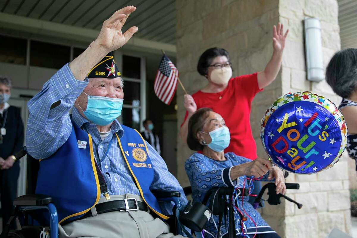 WWII veteran Henry Gee watches vehicles drive by during a parade honoring seven Chinese Americans for the 75th anniversary of the end of WWII hosted by the Chinese American Citizens Alliance in Houston on Saturday, Sept. 5, 2020.