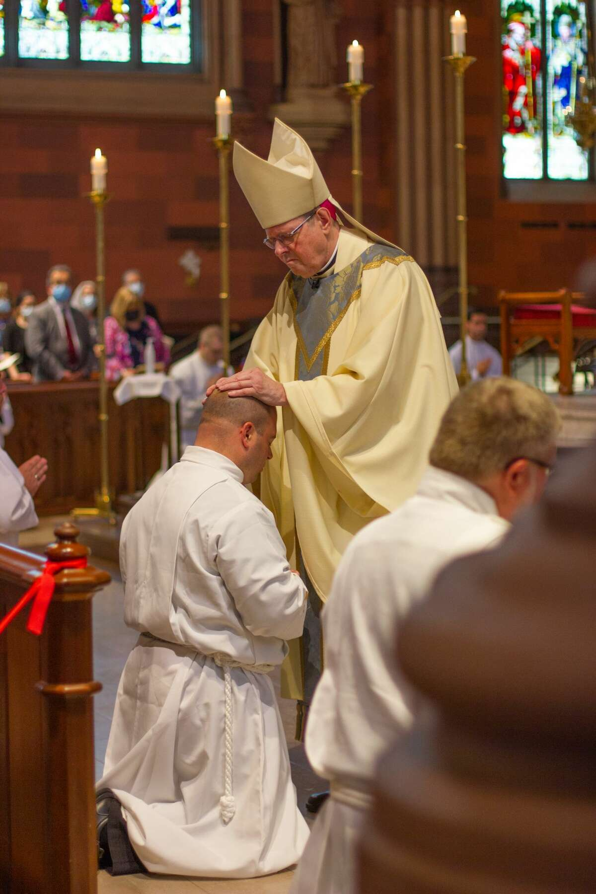 Albany Roman Catholic Diocese Bishop Edward Scharfenberger also ordained five men as transitional deacons and eight as permanent deacons.
