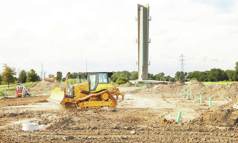 A bulldozer smooths ground near the rows of hookups for a new campground located next to the Hartford Confluence Tower on Illinois Route 3 in Hartford. Five Diamonds Campground is expected to open in October, next to Hartford's Lewis and Clark Confluence Tower, off of Illinois Route 3. Photo: John Badman|The Telegraph