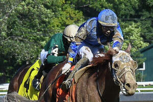 Jockey Jose Ortiz and Mystic Guide in the lead during the stretch run of the Grade II Jim Dandy on Saturday, September 5 at Saratoga Race Course in Saratoga Springs, N.Y. Mystic Guide won by three-quarters of a length. (Mike Kane/Special to the Times Union)