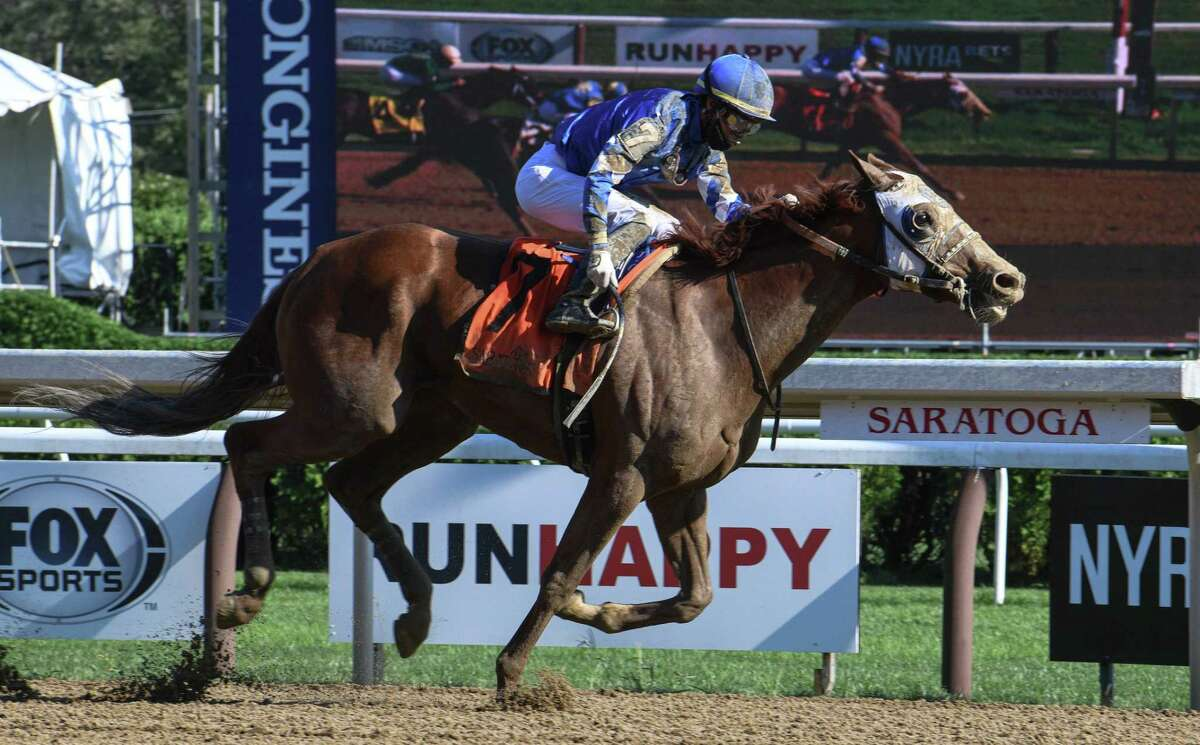 Jockey Jose Ortiz and Mystic Guide are alone at the wire of the Grade II Jim Dandy. Bred and owned by Godolphin, Mystic Guide won by three-quarters of a length over Liveyourbeastlife on Saturday, Sept. 5, 2020 at Saratoga Race Course in Saratoga Springs, N.Y. (Mike Kane/Special to the Times Union)