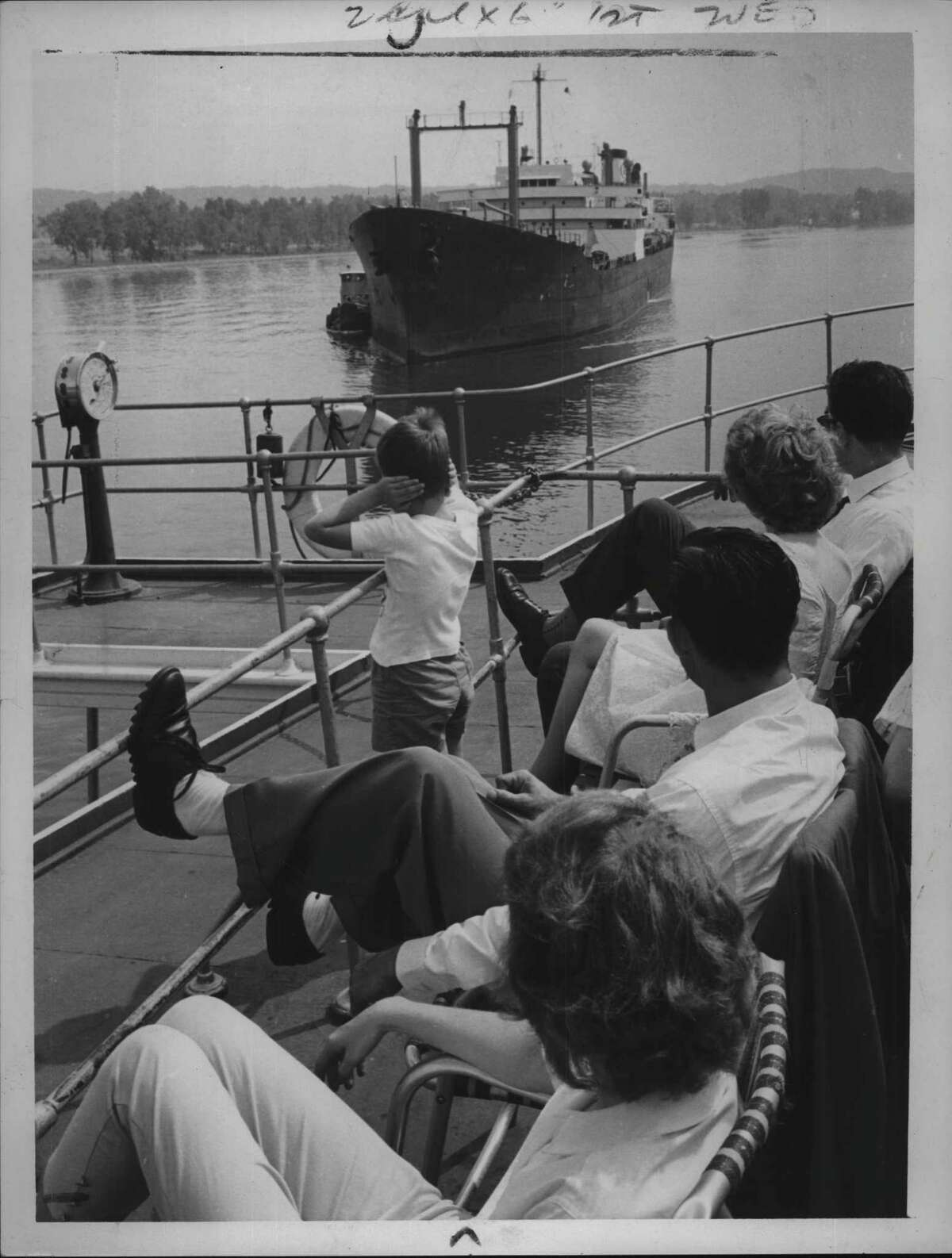 Passengers on the dayliner a€œAlexander Hamiltona€ watch as the vessel passes a tanker on a Sunday cruise on the Hudson River in early September 1961. (Times Union Archive)