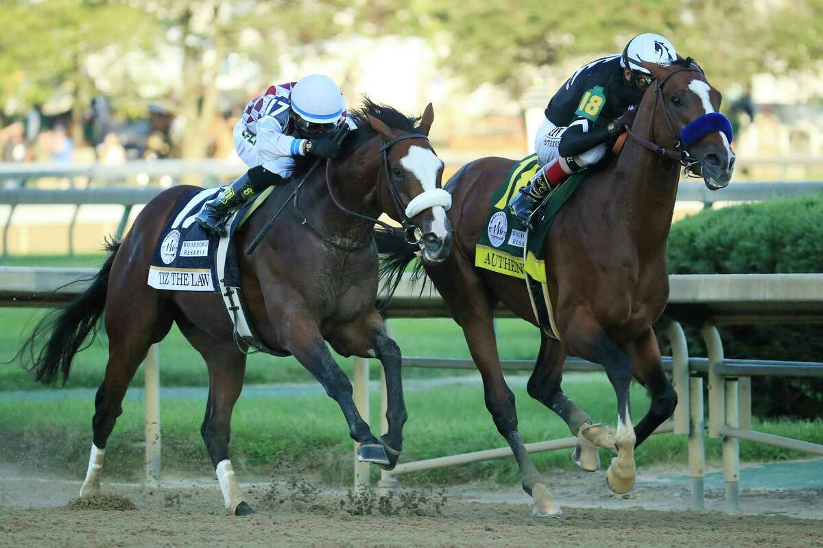 Authentic, right, ridden by jockey John Velazquez, leads Tiz the Law and jockey Manny Franco down the stretch on the way to winning the 146th running of the Kentucky Derby at Churchill Downs. Authentic won the Eclipse Award for Horse of the Year on Thursday.