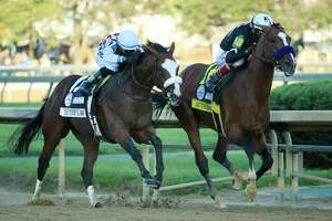 LOUISVILLE, KENTUCKY - SEPTEMBER 05: Authentic #18, ridden by jockey John Velazquez leads Tiz the Law #17, ridden by jockey Manny Franco, down the stretch on the way to winning the 146th running of the Kentucky Derby at Churchill Downs on September 05, 2020 in Louisville, Kentucky.