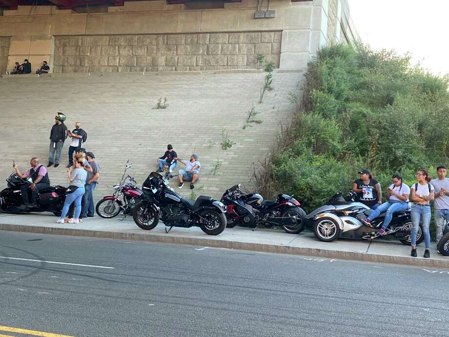 People watch the motorcyclists under I-95 in New Haven. Photo: Mary O'Leary / Hearst Connecticut Media