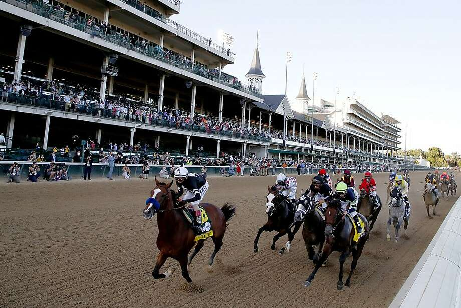 Authentic, with John Velazquez aboard, leads the pack down the stretch at Churchill Downs. Photo: Rob Carr / Getty Images