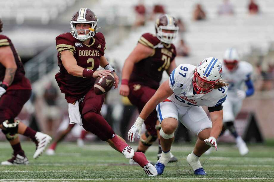 Texas State quarterback Brady McBride escapes SMU's Turner Coxe. McBride tossed two TD passes in his Bobcats debut. Photo: Tim Warner /Getty Images / 2020 Getty Images