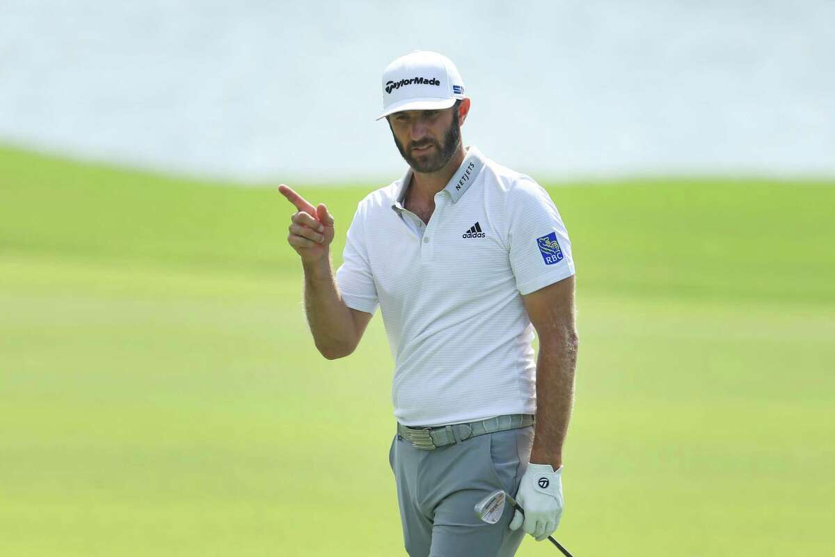 ATLANTA, GEORGIA - SEPTEMBER 05: Dustin Johnson of the United States reacts after chipping in on the eighth hole during the second round of the TOUR Championship at East Lake Golf Club on September 05, 2020 in Atlanta, Georgia. (Photo by Sam Greenwood/Getty Images)