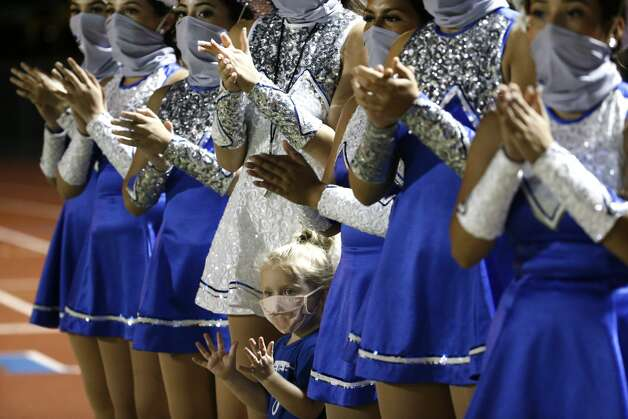 Sadie Jo Lawson wears a mask as she stands with the Needville High School Sapphires dance team during halftime of a football game at Blue Jay Stadium on Friday, Sept. 4, 2020 in Needville. The UIL has sent out warnings to schools to keep stadiums within 50 percent capacity, for spectators to wear masks and other coronavirus precautions. Photo: Brett Coomer/Staff Photographer / © 2020 Houston Chronicle