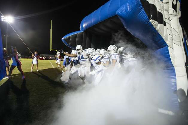 The Needville football team runs out onto the field after halftime of a high school football game against Hargrave at Blue Jay Stadium on Friday, Sept. 4, 2020 in Needville. The UIL has sent out warnings to schools to keep stadiums within 50 percent capacity, for spectators to wear masks and other coronavirus precautions. Photo: Brett Coomer/Staff Photographer / © 2020 Houston Chronicle