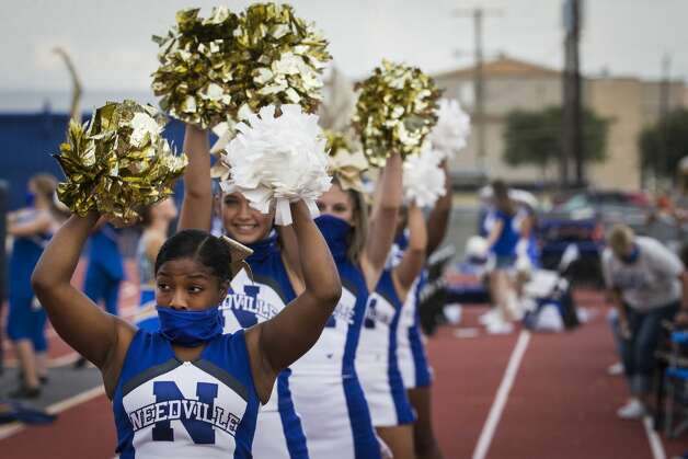 Needville cheerleader Kerra Kiser cheers during a football game against Hargrave at Blue Jay Stadium on Friday, Sept. 4, 2020 in Needville. The UIL has sent out warnings to schools to keep stadiums within 50 percent capacity, for spectators to wear masks and other coronavirus precautions. Photo: Brett Coomer/Staff Photographer / © 2020 Houston Chronicle