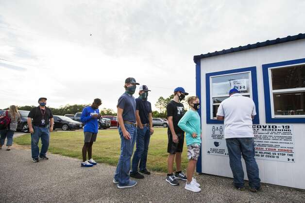 Football fans line up at the ticket booth for a game between Needville and visiting Hargrave at Blue Jay Stadium on Friday, Sept. 4, 2020 in Needville. The UIL has sent out warnings to schools to keep stadiums within 50 percent capacity, for spectators to wear masks and other coronavirus precautions. Photo: Brett Coomer/Staff Photographer / © 2020 Houston Chronicle
