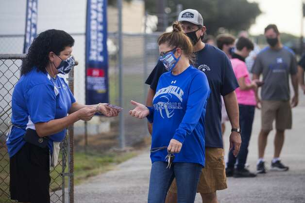 Needville fans walk through the gate for a game against Hargrave at Blue Jay Stadium on Friday, Sept. 4, 2020 in Needville. The UIL has sent out warnings to schools to keep stadiums within 50 percent capacity, for spectators to wear masks and other coronavirus precautions. Photo: Brett Coomer/Staff Photographer / © 2020 Houston Chronicle