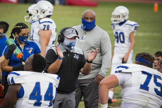 Needville defensive coordinator Travis Hoffer wears a mask as he talks to his players during a game against Hargrave at Blue Jay Stadium on Friday, Sept. 4, 2020 in Needville. The UIL has sent out warnings to schools to keep stadiums within 50 percent capacity, for spectators to wear masks and other coronavirus precautions. Photo: Brett Coomer/Staff Photographer / © 2020 Houston Chronicle