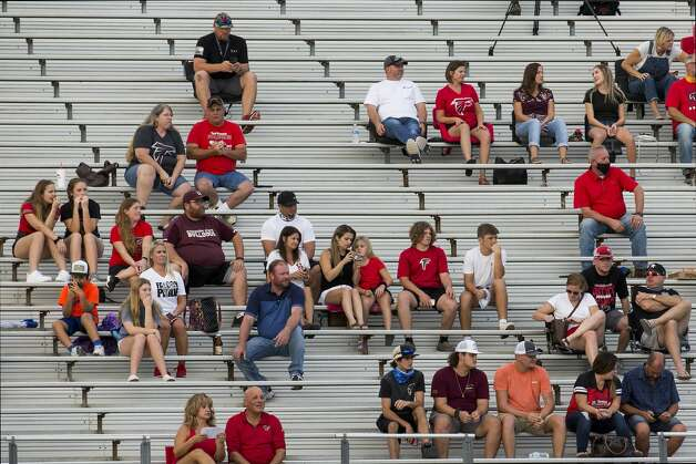 Hargrave fans sit in the stands watching a game between the visiting Falcons and Needville at Blue Jay Stadium on Friday, Sept. 4, 2020 in Needville. The UIL has sent out warnings to schools to keep stadiums within 50 percent capacity, for spectators to wear masks and other coronavirus precautions. Photo: Brett Coomer/Staff Photographer / © 2020 Houston Chronicle
