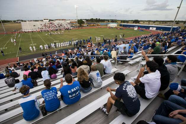 Football fans sit in the stands for a game between Needville and Hargrave at Blue Jay Stadium on Friday, Sept. 4, 2020 in Needville. The UIL has sent out warnings to schools to keep stadiums within 50 percent capacity, for spectators to wear masks and other coronavirus precautions. Photo: Brett Coomer/Staff Photographer / © 2020 Houston Chronicle