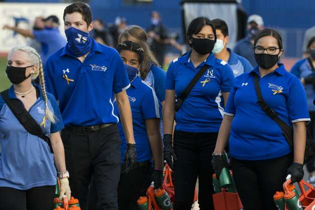 Needville student trainers all wear masks during a game against Hargrave at Blue Jay Stadium on Friday, Sept. 4, 2020 in Needville. The UIL has sent out warnings to schools to keep stadiums within 50 percent capacity, for spectators to wear masks and other coronavirus precautions. Photo: Brett Coomer/Staff Photographer / © 2020 Houston Chronicle