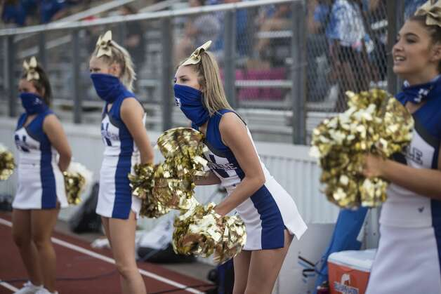 Needville cheerleaders cheer on the sidelines during a game against Hargrave at Blue Jay Stadium on Friday, Sept. 4, 2020 in Needville. The UIL has sent out warnings to schools to keep stadiums within 50 percent capacity, for spectators to wear masks and other coronavirus precautions. Photo: Brett Coomer/Staff Photographer / © 2020 Houston Chronicle