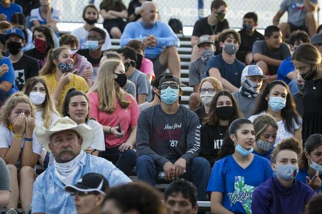 Needville football fans watch a game against Hargrave at Blue Jay Stadium on Friday, Sept. 4, 2020 in Needville. The UIL has sent out warnings to schools to keep stadiums within 50 percent capacity, for spectators to wear masks and other coronavirus precautions. Photo: Brett Coomer/Staff Photographer / © 2020 Houston Chronicle