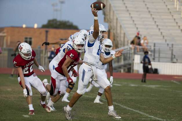 Needville quarterback Trevor Baker (10) rolls out to pass against Hargrave at Blue Jay Stadium on Friday, Sept. 4, 2020 in Needville. The UIL has sent out warnings to schools to keep stadiums within 50 percent capacity, for spectators to wear masks and other coronavirus precautions. Photo: Brett Coomer/Staff Photographer / © 2020 Houston Chronicle