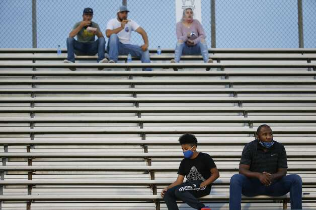 Hargrave fans sit apart in the stands as they watch the game against Needville at Blue Jay Stadium on Friday, Sept. 4, 2020 in Needville. The UIL has sent out warnings to schools to keep stadiums within 50 percent capacity, for spectators to wear masks and other coronavirus precautions. Photo: Brett Coomer/Staff Photographer / © 2020 Houston Chronicle