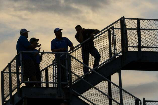 Needville fans watch a game against Hargrave at Blue Jay Stadium on Friday, Sept. 4, 2020 in Needville. The UIL has sent out warnings to schools to keep stadiums within 50 percent capacity, for spectators to wear masks and other coronavirus precautions. Photo: Brett Coomer/Staff Photographer / © 2020 Houston Chronicle