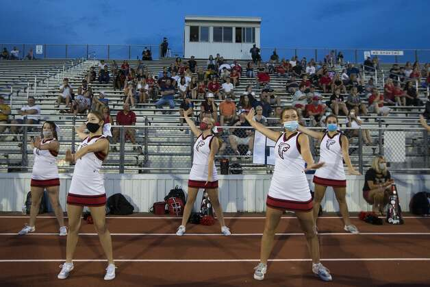 Hargrave cheerleaders cheer during a game against Needville at Blue Jay Stadium on Friday, Sept. 4, 2020 in Needville. The UIL has sent out warnings to schools to keep stadiums within 50 percent capacity, for spectators to wear masks and other coronavirus precautions. Photo: Brett Coomer/Staff Photographer / © 2020 Houston Chronicle