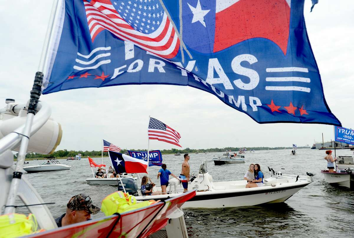 Boats make their way up the Neches River past Riverfront Park in Pofrt Neches, where crowds lined the riverfront to cheer and watch Saturday's Trump Boat Parade 2020. Photo taken Saturday, September 5, 2020 Kim Brent/The Enterprise