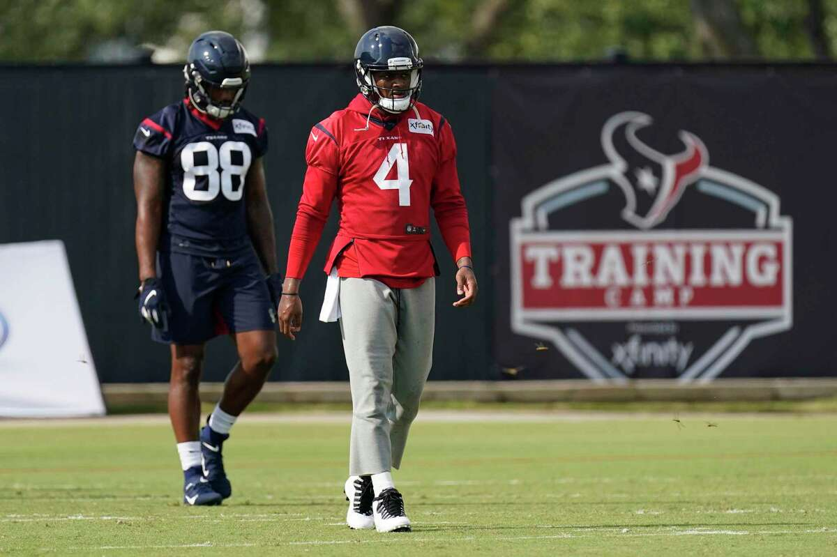 Houston Texans quarterback Deshaun Watson (4) walks down the field during an NFL training camp football practice Friday, Aug. 21, 2020, in Houston. (AP Photo/David J. Phillip)