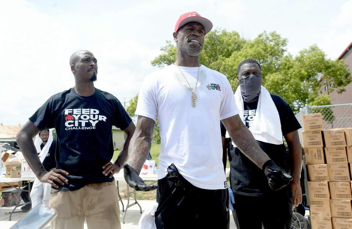 Port Arthur native and NBA player Stephen Jackson joins volunteers with Feed Your City Challenge Ricky Davis (left) and Tony Draper, to talk about the mission of their event as they prepare for Saturday's food and supply distribution to those impacted by Hurricane Laura in Port Arthur. Photo taken Saturday, September 5, 2020 Kim Brent/The Enterprise