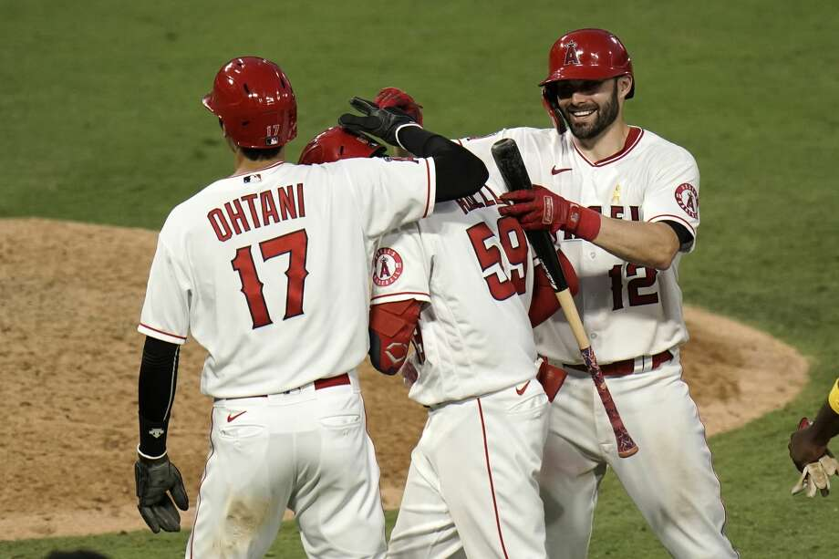 Los Angeles Angels' Jo Adell, center, is congratulated by Shohei Ohtani, right, of Japan, and Anthony Bemboom after hitting a walkoff single in the seventh inning of the first baseball game of a doubleheader against the Houston Astros, Saturday, Sept. 5, 2020, in Anaheim, Calif. (AP Photo/Jae C. Hong) Photo: Jae C. Hong/Associated Press / Copyright 2020 The Associated Press. All rights reserved.
