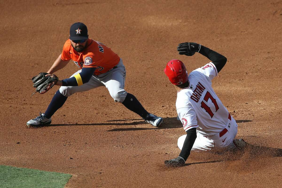 ANAHEIM, CALIFORNIA - SEPTEMBER 05: Shohei Ohtani #17 of the Los Angeles Angels safely steals second base as Jack Mayfield #9 of the Houston Astros attempts the tag during the first inning of the first game of a double header at Angel Stadium of Anaheim on September 05, 2020 in Anaheim, California. (Photo by Sean M. Haffey/Getty Images)