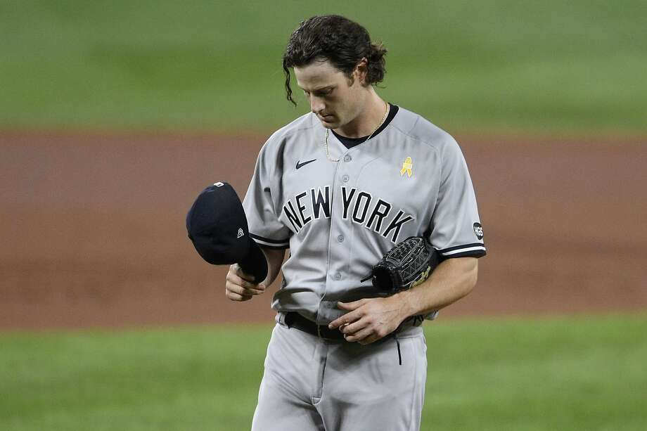 Yankees starting pitcher Gerrit Cole pauses on the mound in the fourth inning of a loss in Baltimore. Photo: Nick Wass / Associated Press