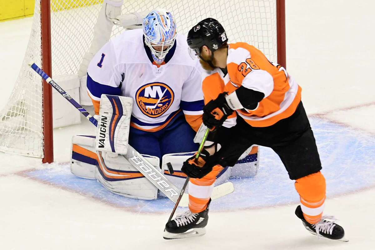 New York Islanders goaltender Thomas Greiss (1) stops Philadelphia Flyers left wing Claude Giroux (28) during first-period NHL Stanley Cup Eastern Conference playoff hockey game action in Toronto, Saturday, Sept. 5, 2020. (Frank Gunn/The Canadian Press via AP)