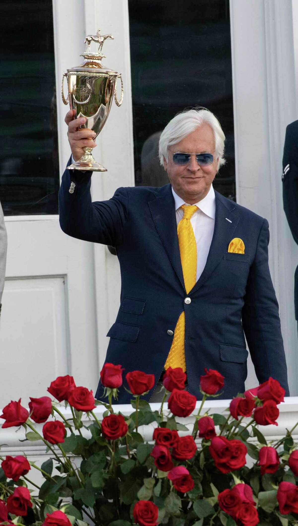 Trainer Bob Baffert holds the winnerA?•s trophy aloft after his charge Authentic with jockey John Velazquez won the 146th running of the Kentucky Derby at Churchill Downs Race Course Saturday Sept 5, 2020 in Louisville, KY. Photo by Skip Dickstein/Special to the Times Union
