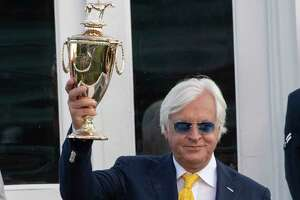 Trainer Bob Baffert holds the winnerA•s trophy aloft after his charge Authentic with jockey John Velazquez won the 146th running of the Kentucky Derby at Churchill Downs Race Course Saturday Sept 5, 2020 in Louisville, KY.  Photo by Skip Dickstein/Special to the Times Union