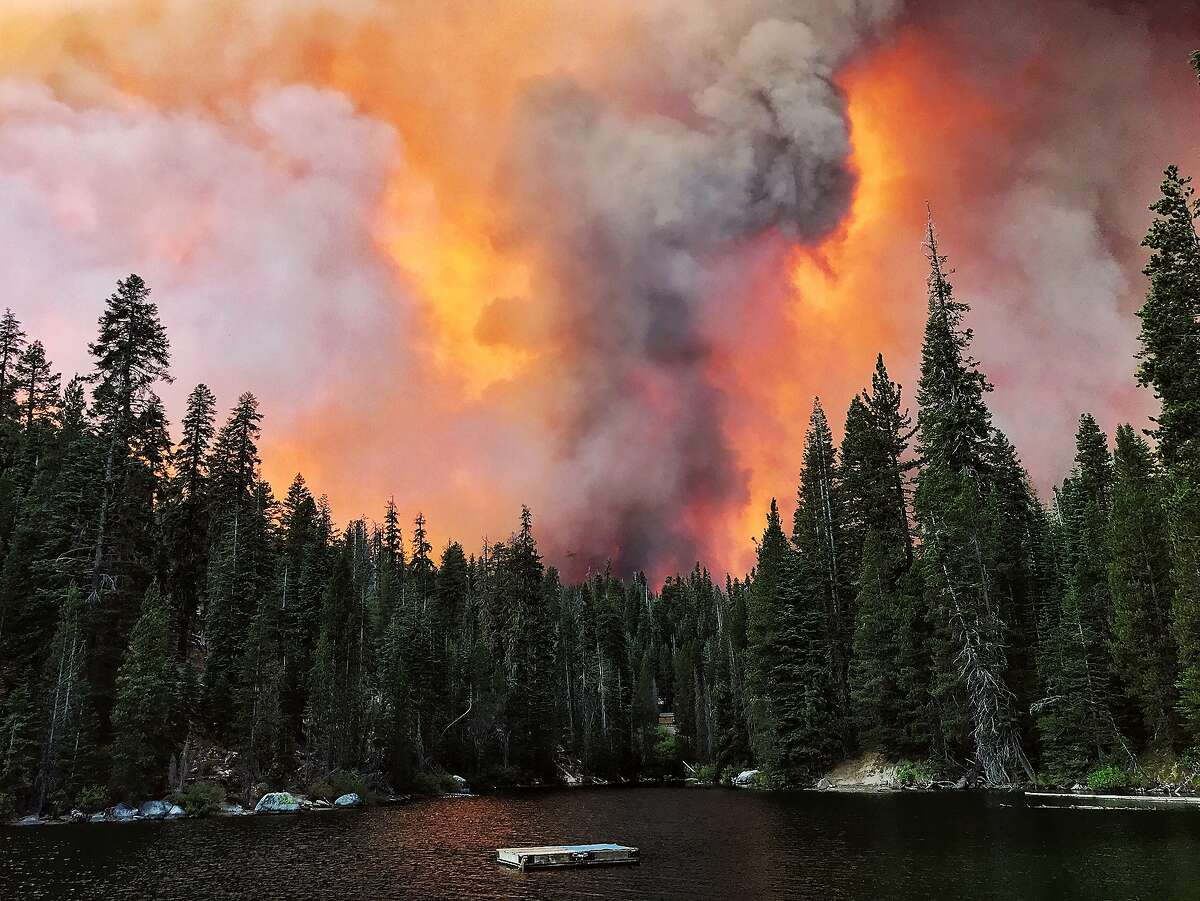 Smoke from the Creek Fire billows beyond a ridge as seen from Huntington Lake on Saturday, Sept. 5, 2020, at Huntington Lake, Calif. (Eric Paul Zamora/The Fresno Bee via AP)