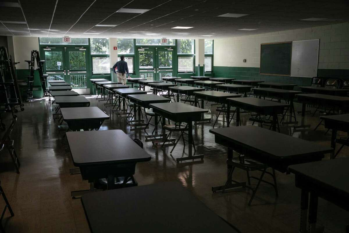 Rippowam Middle School Principal Matthew Laskowski looks on from a socially distanced cafeteria on September 03, 2020 in Stamford, Connecticut.