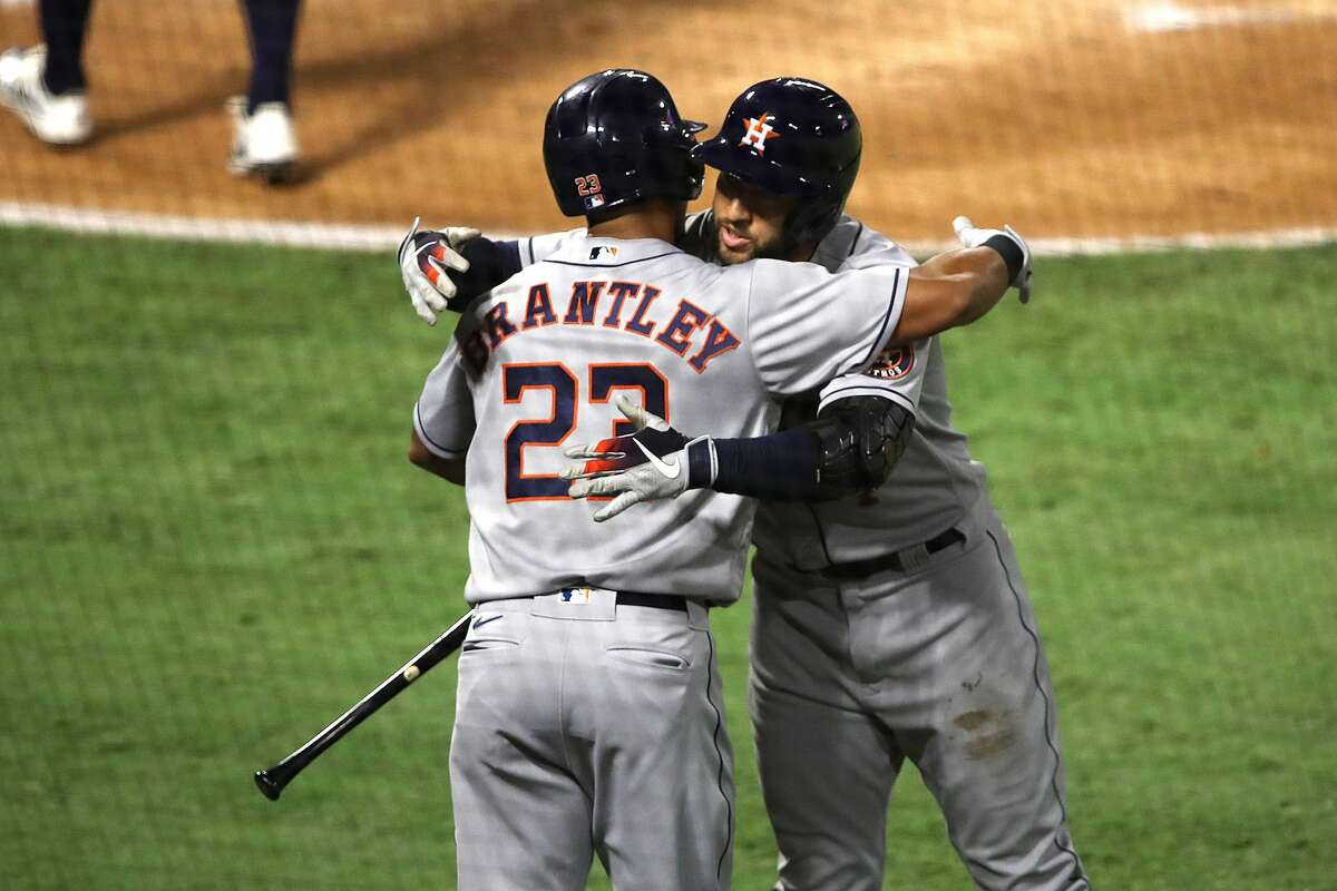 ANAHEIM, CALIFORNIA - SEPTEMBER 05: Josh Reddick #22 congratulates George Springer #4 of the Houston Astros after his solo homerun during the first inning of the second game of a double header against the Los Angeles Angels at Angel Stadium of Anaheim on September 05, 2020 in Anaheim, California. (Photo by Sean M. Haffey/Getty Images)