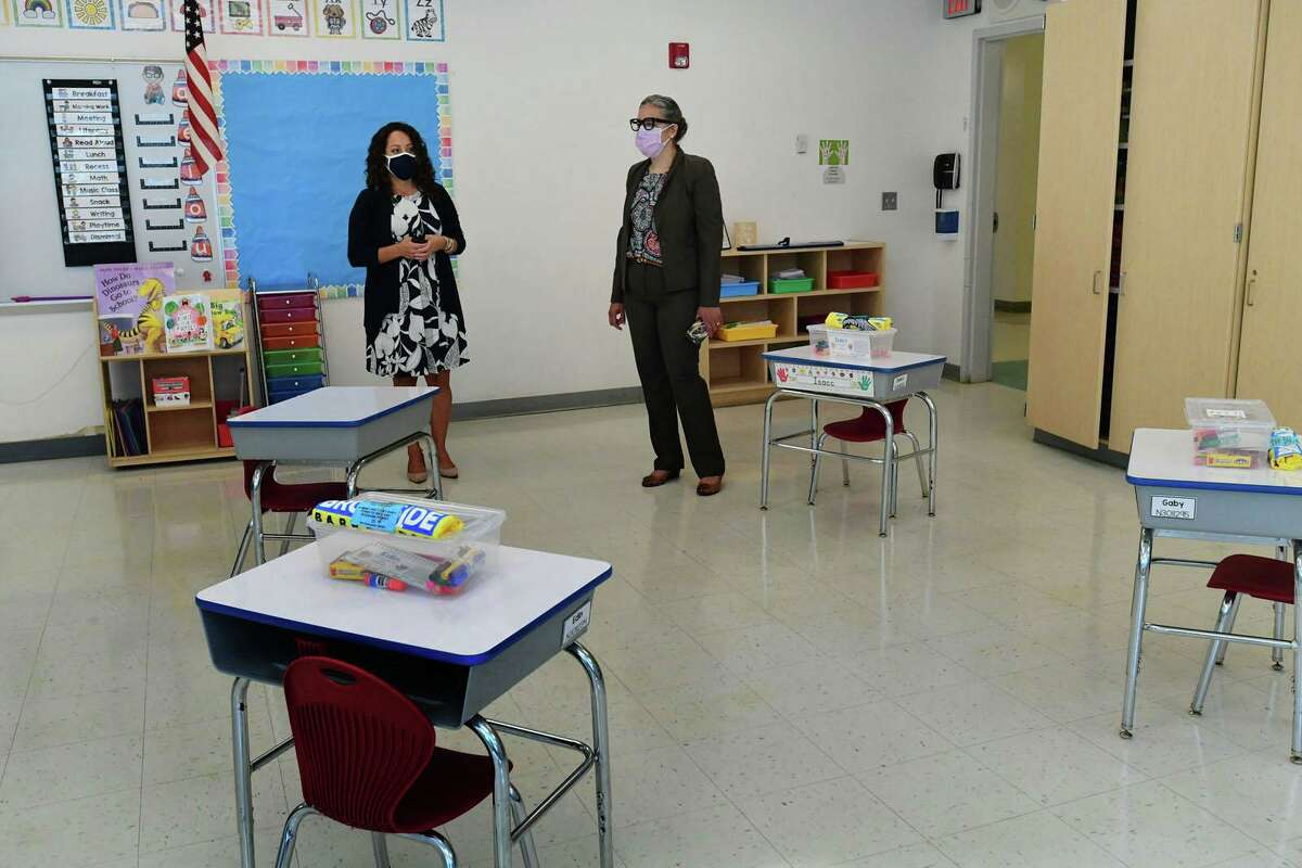 New principal Christina Guerra leads a walk through of Brookside Elementary School with new superintendent Dr. Alexandra Estrella Friday, September 4, 2020, to show the last minute safety preparartions taking place at the school in Norwalk, Conn.