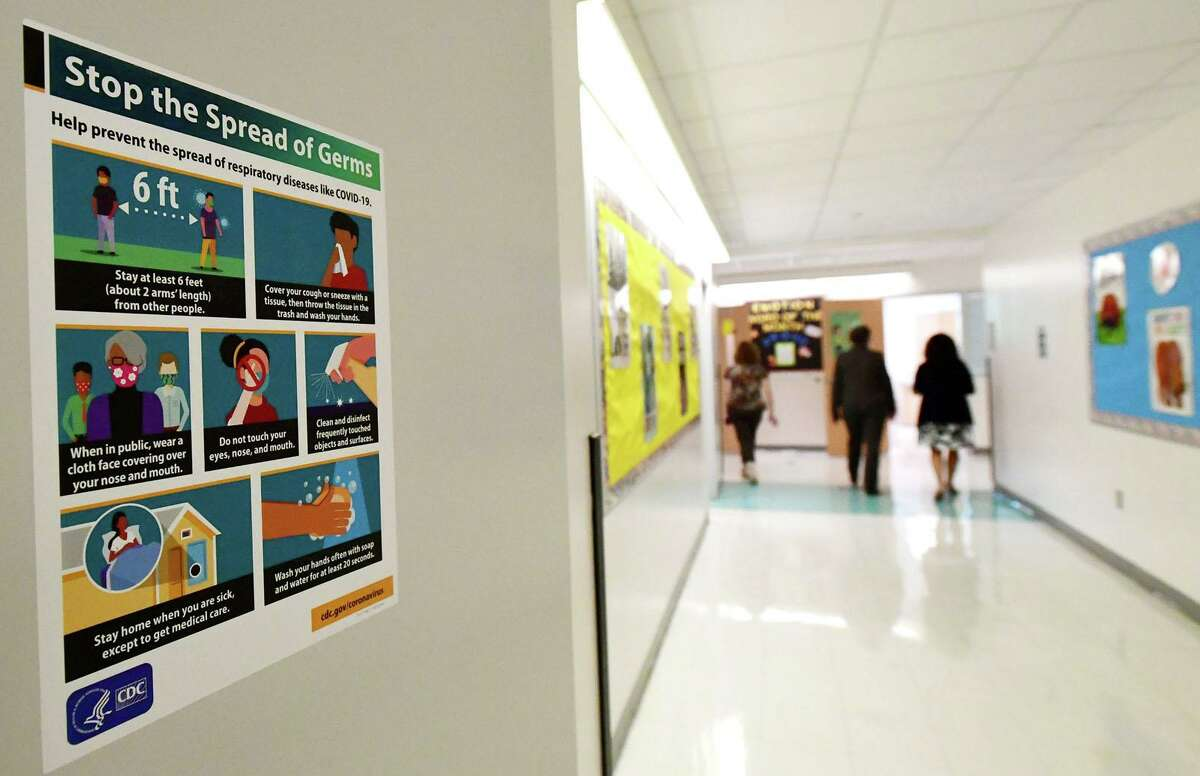 New principal Christina Guerra leads a walk through of Brookside Elementary School with new superintendent Dr. Alexandra Estrella Friday, September 4, 2020, to show the last minute safety preparations taking place at the school in Norwalk, Conn.