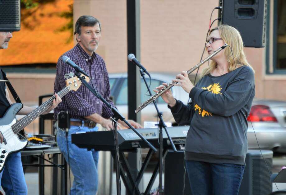 Patrons took advantage of the closed roadways in downtown Midland on Saturday night, Sept. 5, by listening to live music by Coleman Road, eating at the various restaurants and spending time with friends and family. (Ashley Schafer/Ashley.Schafer@hearstnp.com) Photo: Ashley Schafer