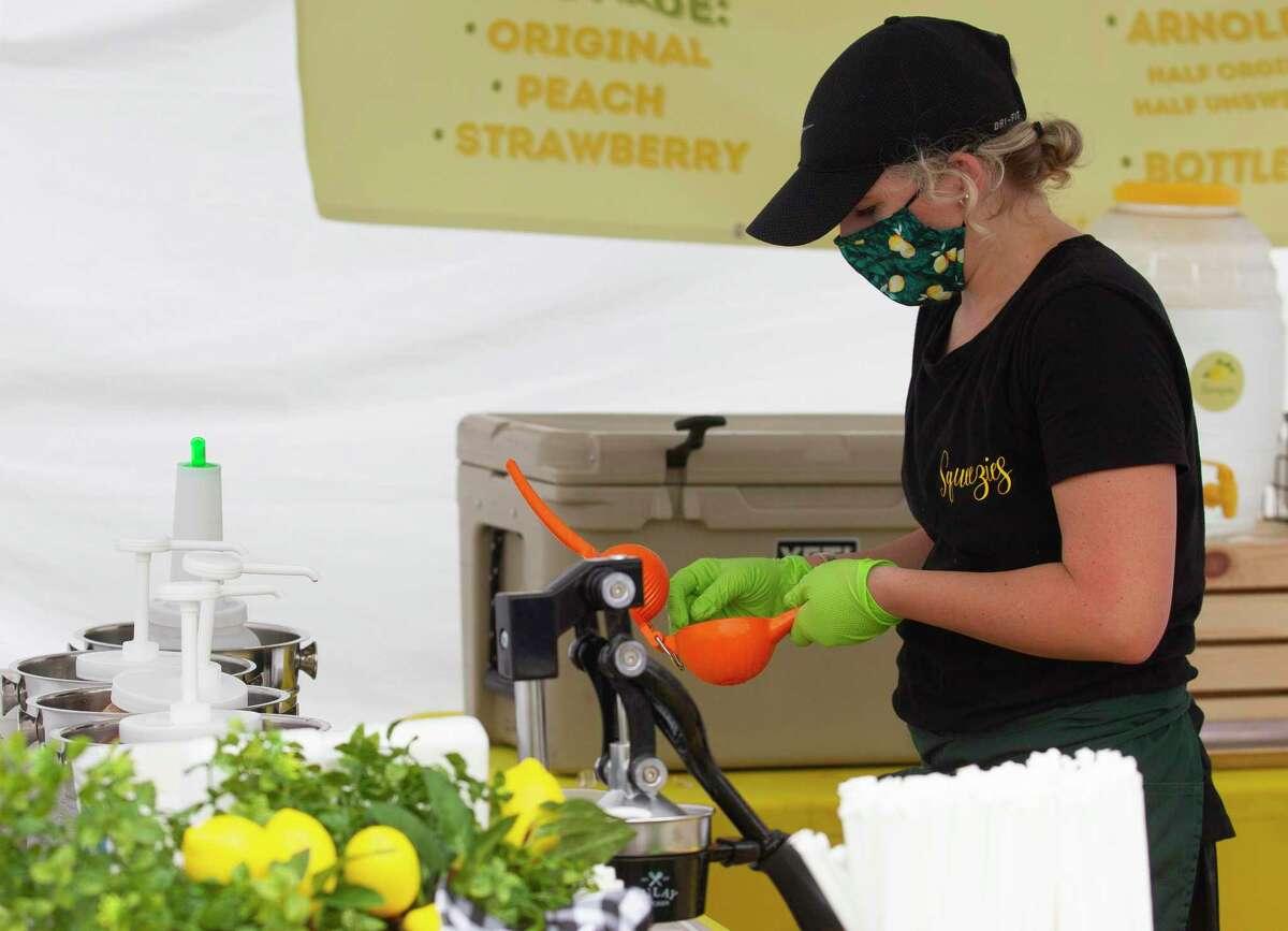 Sam Bratsch squeezes lemons for lemonade at the new Oak Ridge Pop Up Market on Saturday.